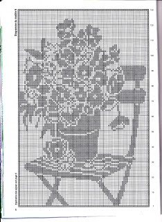Flowers in a chair filet crochet chart. Might have to do this one in color.
