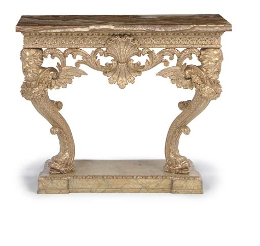 A GEORGE II GILTWOOD PIER TABLE  MID-18TH CENTURY, THE APRON LATER  With later Sicilian jasper top above a pierced guilloche and flowerhead frieze centred by a shell and inverted with foliate scroll ornaments, on serpentine legs with winged masks and floral festoons terminating in dolphin feet, inscribed in paint 'No 2', with 19th century simulated Siena marbled plinth, re-gilt  34½ in. (87.5 cm.) high; 43½ in. (110.5 cm.) wide; 27½ in. (57 cm.) deep