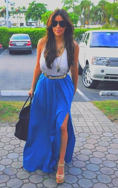 Blue maxi skirt with a high slit, white tank top and long gold necklaces layered give a casual chic look.