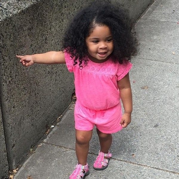 Gorgeous baby girl looking pretty in pink