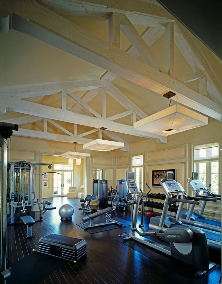 Awesome Exercise Equipment decorating ideas for Arresting Home Gym Traditional design ideas with ceiling lighting dark floor exposed beams free weights gym equipment sloped ceiling
