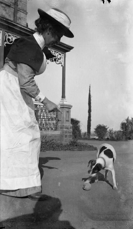 SECOND BOER WAR 1899-1902 (Q 72504). Sister A. R.R. Innes and Babs the dog in the grounds of the 22 General Hospital, Pretoria.