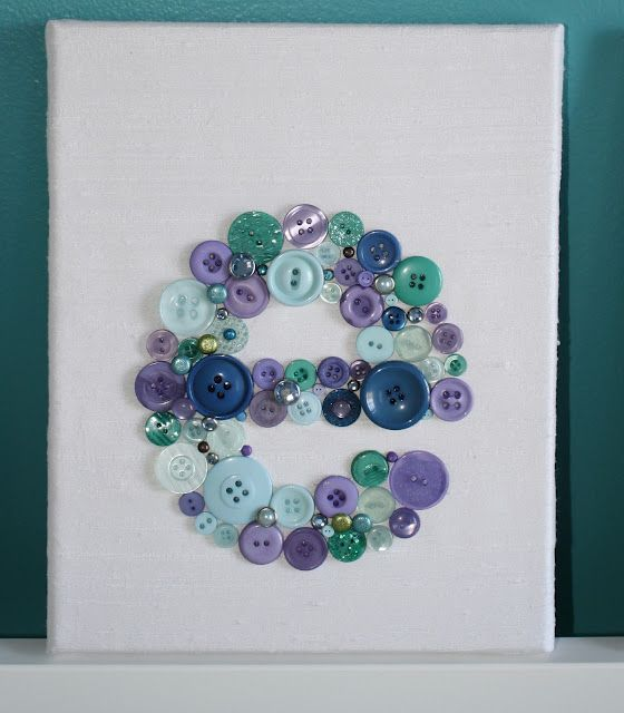 Fabric covered canvas/button letters.  Great for nursery or to use as simple monogram art for your home.