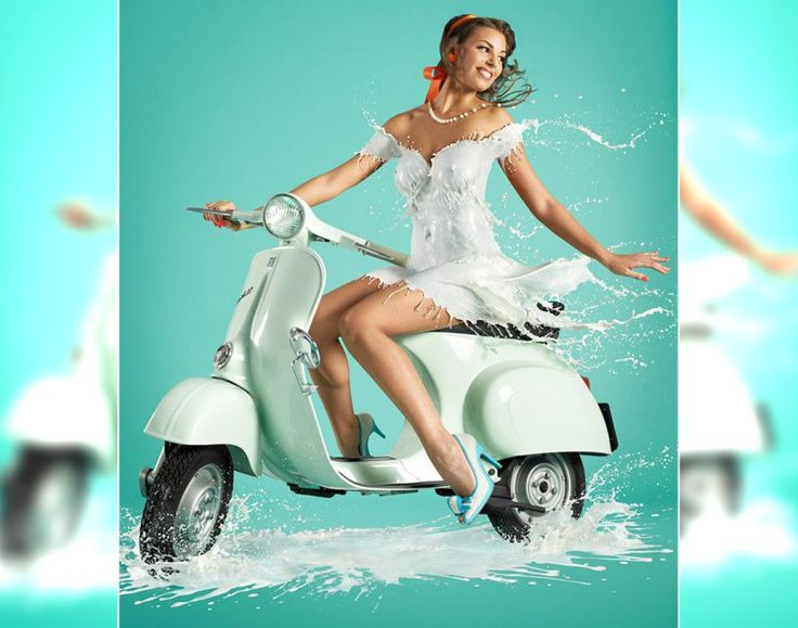 """Milk on the go! More than 200 frames were taken by London-based photographer Jaroslav Wieczorkiewicz, who then layered the shots in Photoshop into a single image, creating the illusion that these pin-up girls are wearing milk """"dresses."""""""