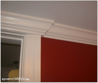 Crown Molding Above Doorway With A Low Ceiling In Powder