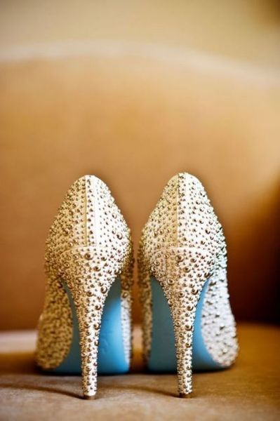 Wedding shoes. Blue bottom Louboutins. Something blue.