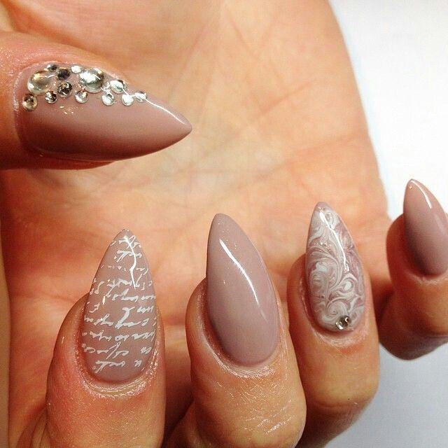 Nudish stiletto nail