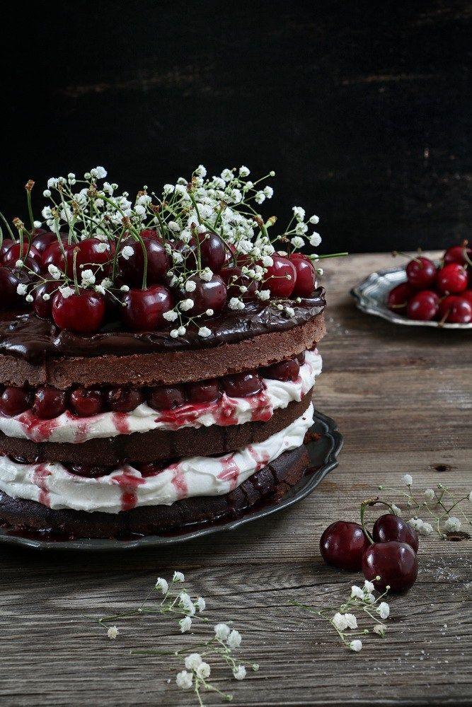 Three Layered Chocolate Cake with Vanilla Wipped Cream and Cherries