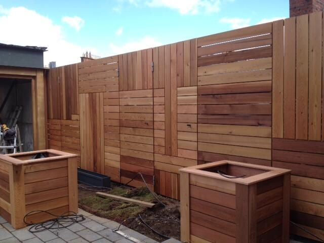 construction of cedar wall and planters designed by Doyle landscapes
