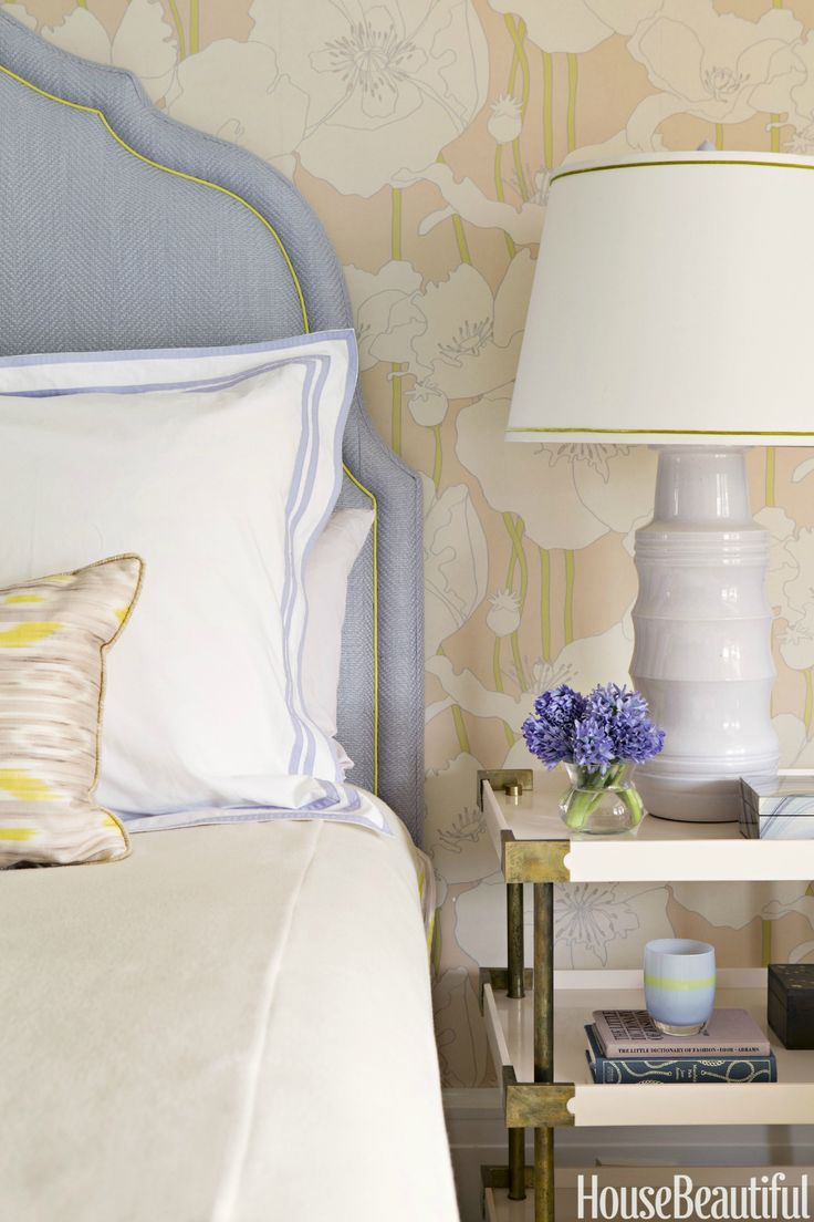 A headboard in Glant's Couture Herringbone piped in citrus green grounds the ethereal guest room.