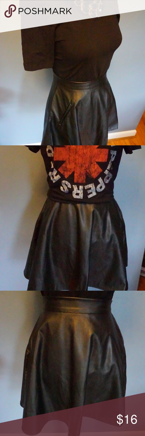 Black Faux Leather Skater Skirt Black Faux Leather Skater Skirt. Meant to be worn on waist. Faux pockets. So cute with a band tee.  Never worn because it's too small. Skirts Mini