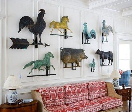 displayed collection of antique weather vanes