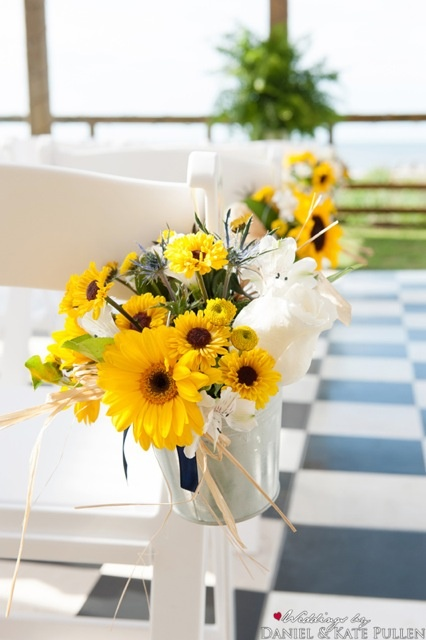 Sunflowers lined the aisle- bright and cheerful. These flowers are great to photograph.Abby & Scott had an classic and elegant maritime theme to their wedding at the Inn on the Pamlico Sound in Buxton