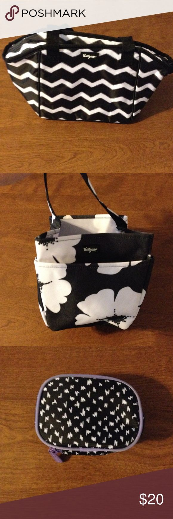 Black and white bags from thirty one Chevron is a lunch box, the second one is a organizer caddy  and small carrying case. All new thirty-one Bags