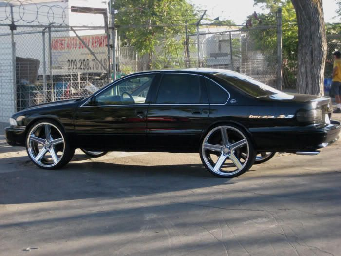 One of the two vehicles that I want: Black '96 Impala SS with IRocs.