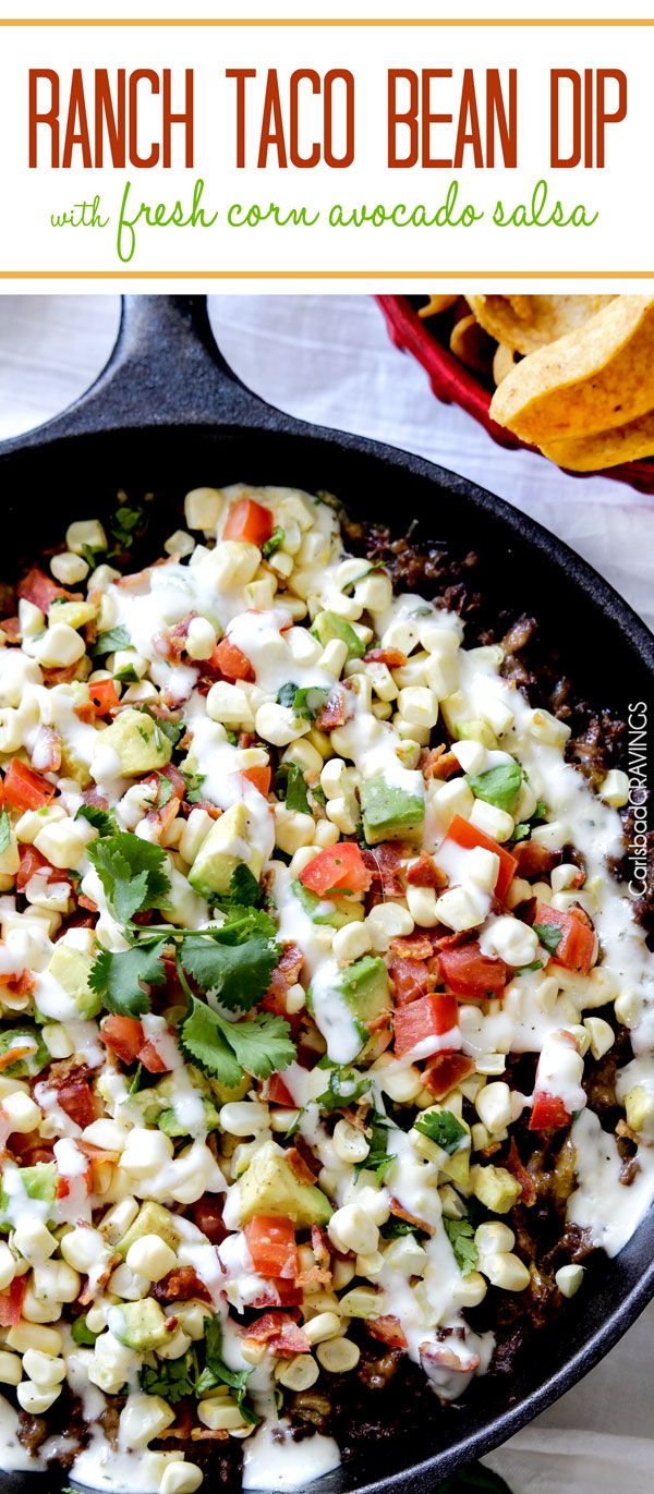 My absolute favorite dip! everyone always asks me for the recipe. Creamy bean dip layered with cheese, ranch spiced beef, more cheese and refreshing fresh corn, avocado salsa. #beandip #tacodip #Mexican