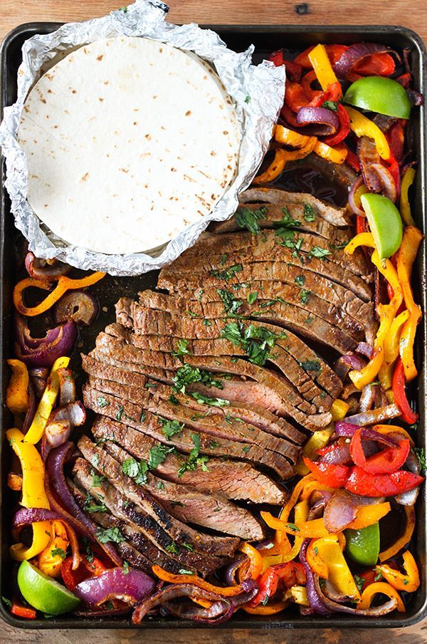 These Sheet Pan Steak Fajitas are so delicious and exceptionally easy to make! Tender seasoned flank steak with colorful onions and bell peppers all cooked together on just one sheet pan. This dinner is truly restaurant quality and you can have it on the table in about 30 minutes. It's perfect for busy week nights …