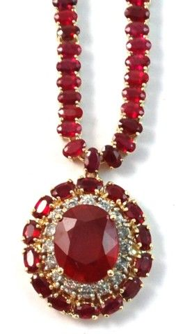 RUBY AND FOURTEEN KARAT GOLD NECKLACE, featuring an oval-cut ruby weighing approximately 11.09 cts. along with 149 oval-cut rubies and 16 round, brilliant-cut diamonds. Total estimated weight for all rubies: 54.36 cts.; all diamonds: 1.25 cts.