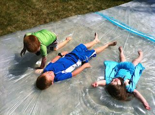 "Giant ""water bed"" outside sensory bag. Essentially a $10 painting drop cloth,"