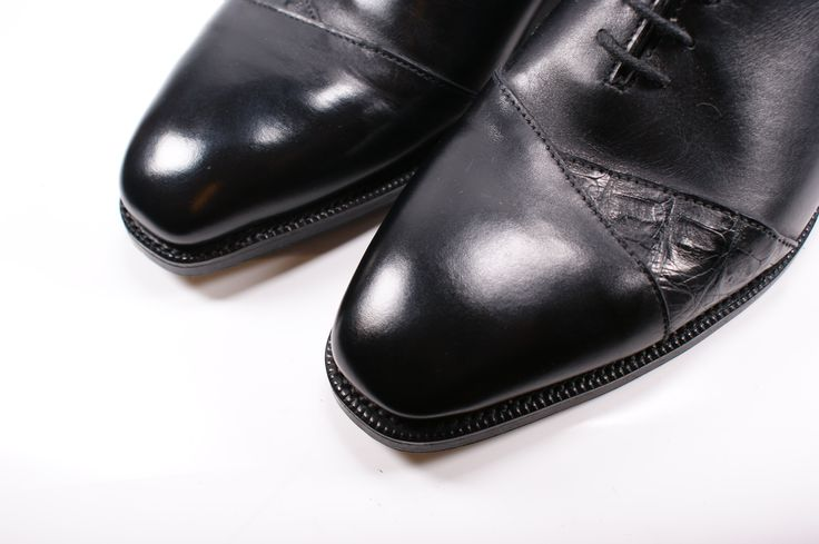 A black calf and caiman leather oxford made here on a chisel toe last. Designed by a groom who wanted a traditional black shoe with a personal twist. Design your own handmade, made to order shoes online at www.gilbertandbailey.com. Prices form £690.