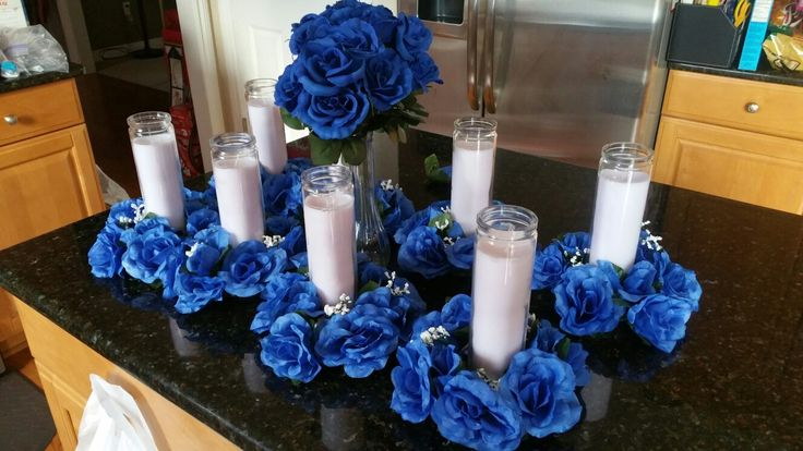 Repast centerpieces...candle rings, tall white candles ...