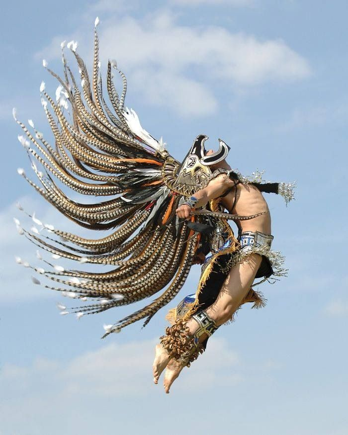 Aztec dancer in flight. I believe that head dress' size was somewhat increased digitaly but still a great shot
