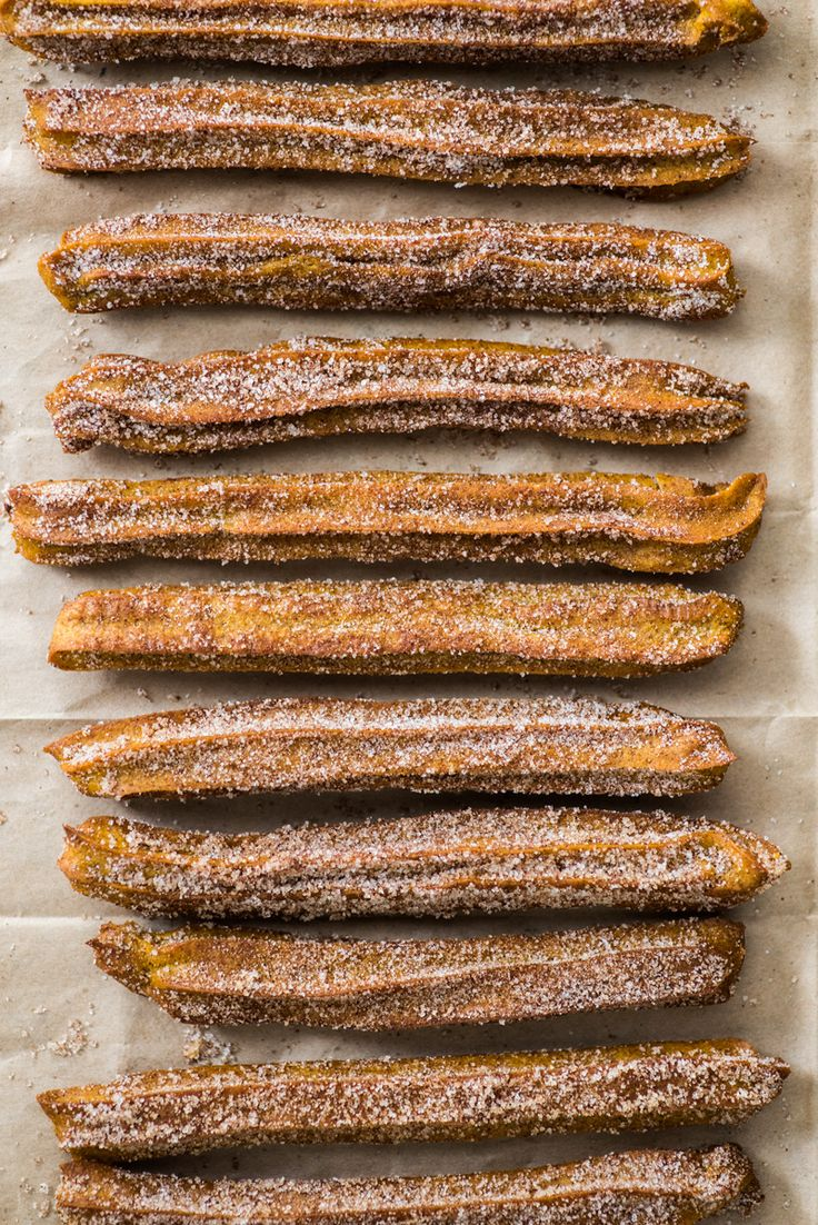 Baked Pumpkin Churros covered in cinnamon sugar are the perfect fall and winter dessert. They're baked, not fried, which means you can eat more of them! #pumpkinrecipes #churros