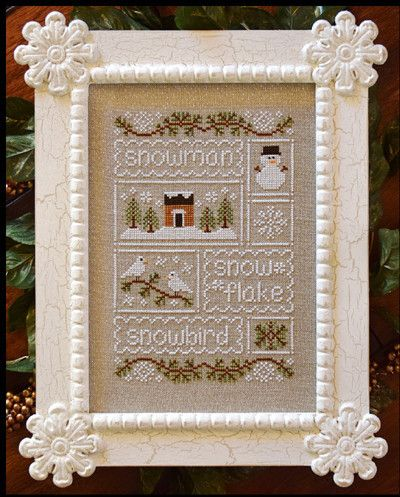 Country Cottage Needleworks Snow Sampler - Cross Stitch Pattern. Snowman, Snowflake, Snowbird. Model stitched on 32 Ct. Raw/Silver linen using DMC and Gentle Ar