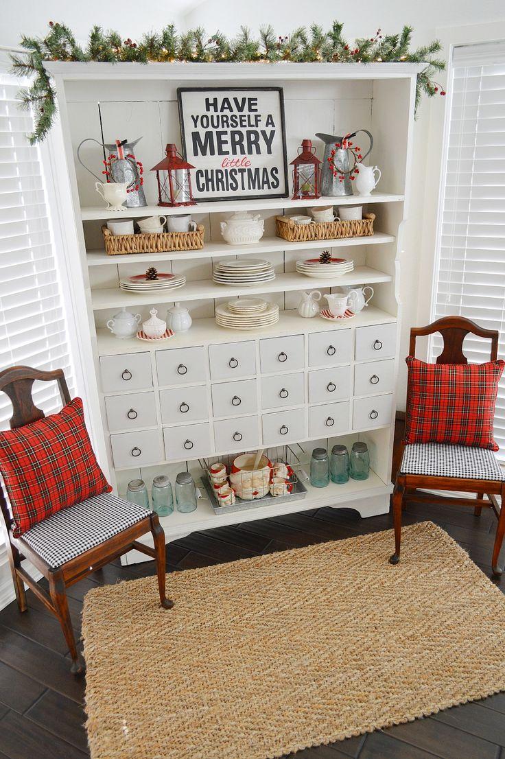 Holiday Home Tour. Christmas kitchen & sun room at Fox Hollow Cottage. Apothecary Cabinet Dressed in Red, Plaid, Lanterns, Vintage Ball Mason Jars & Santa Claus Punch Bowl and Mug Set.