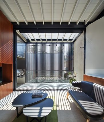 A small family room at the western end of the top floor provides an alternative to the main, larger living space and opens out onto a protected courtyard.