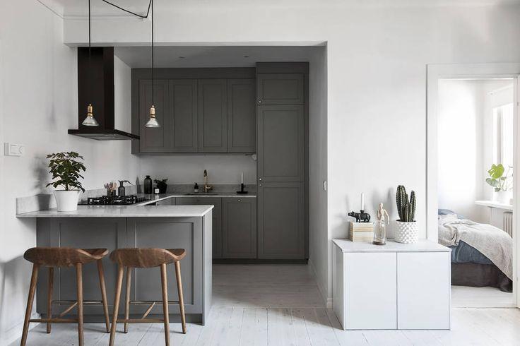 Dark gray kitchen with brass details