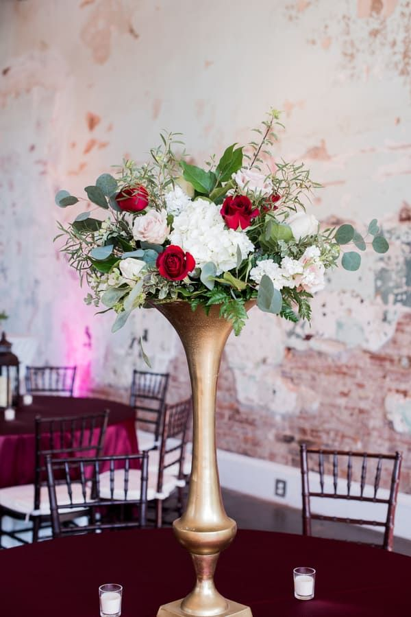 Tall Skinny Gold Vase With Red Green And White Formal Floral