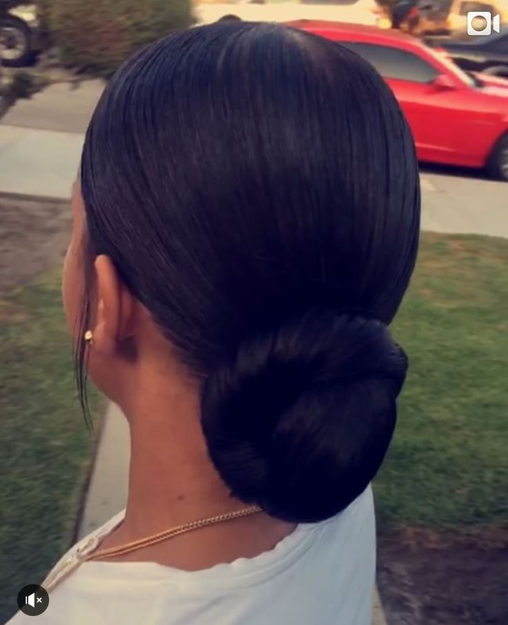 Slicked ponytail with bun. Ponytail with extension. Full twisted bun