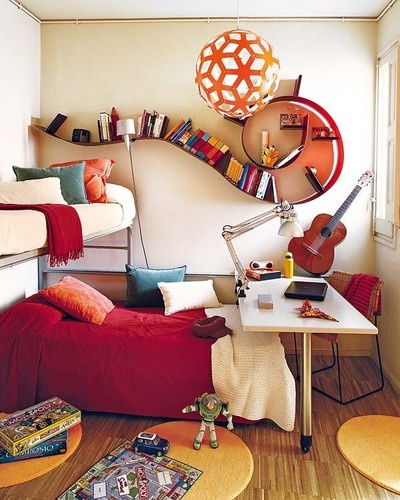 Two beds, one desk and an amazing book shelf.