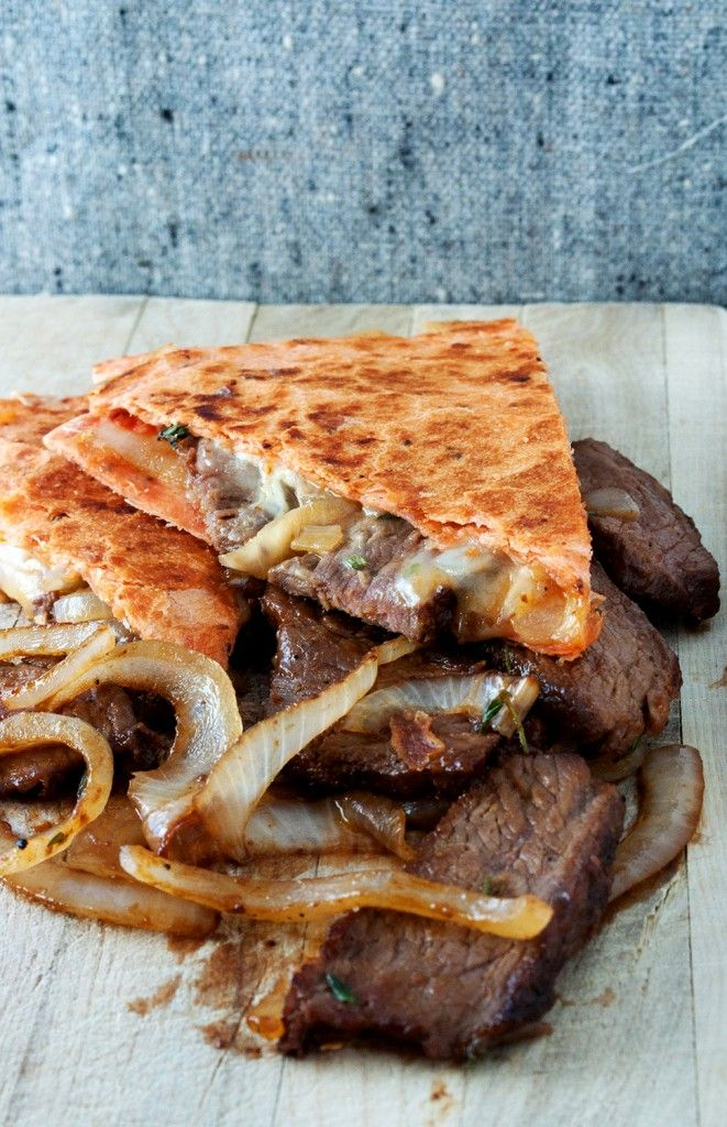 caramelized onion and steak quesadilla. bet these would be good on the panini maker!