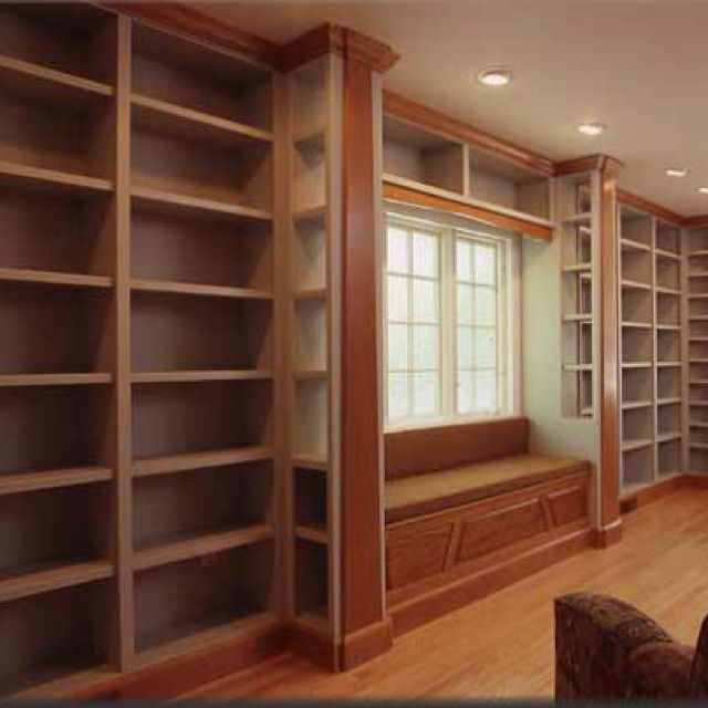 Home library...I really like the reading bench/window set off by extra shelving. It looks cozy and tidy.