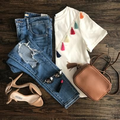 Amanda Miller posting a white top with colorful tassels