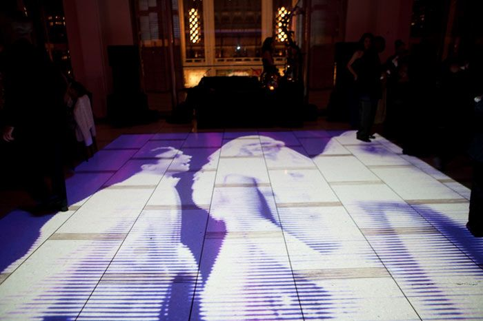 The American Ballet Theatre's 2009 fall gala in New York got guests moving after the performance with projections on the dance floor. The floor played images of 1950s movies during dinner, and later busy street scenes moved in time with the music for dancing.The look aimed to complement the troupe's contemporary and unconventional programming, with dark colors and silhouettes inspired by artist Kara Walker.