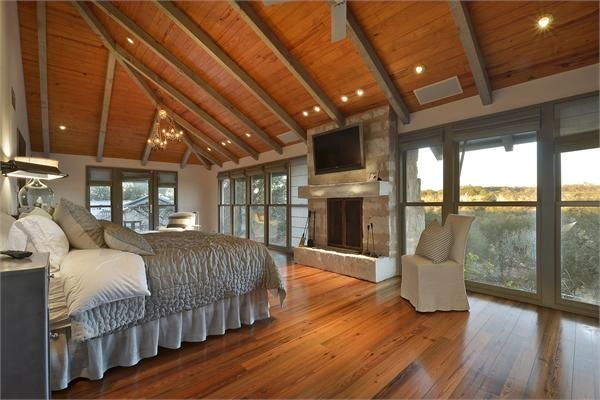 Warm bedroom with views of the Texas Hill Country.                                                                                                                                                                                 More