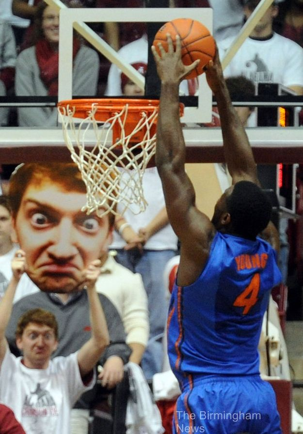 This guy is genius   He took funny photos of himself  blew them up  and holds them up WHILE MAKING THE SAME FACE to distract basketball players at game time   Helps that he  39 s kinda funny lookin  39   too