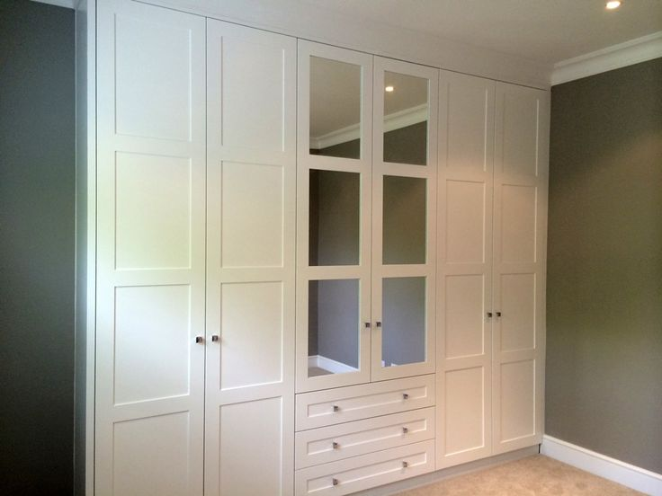 fitted wardrobe with mirror inserts