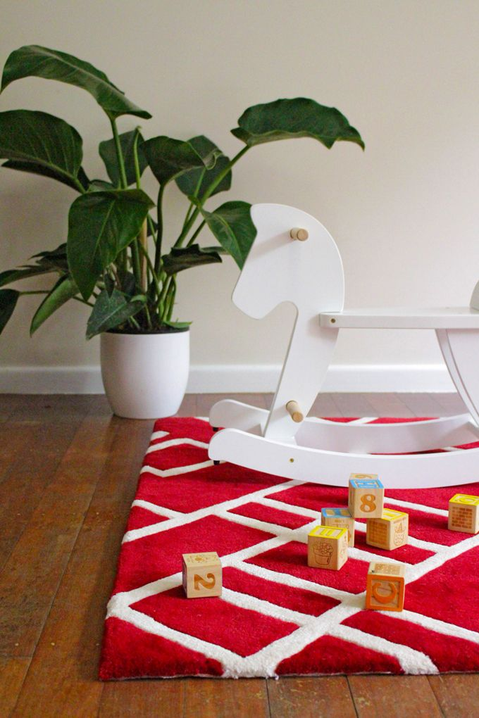 The Design Collection red rug is perfect for your kids room. Add a little fun to your floor!