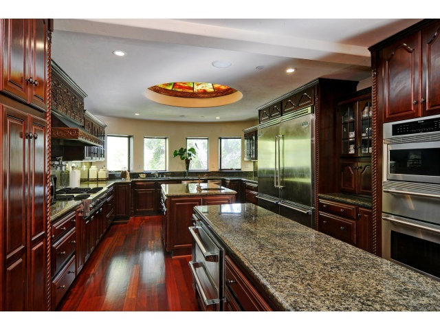 Dream kitchen...two islands, cherry wood cabinets...