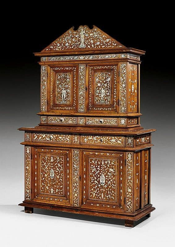 "CABINET,Renaissance, Loire region circa 1570/80. Walnut, ivory and mother of pearl with exceptionally fine inlays; allegorical figures of ""abondance"" and Minerva, lions, chimera, flowers, leaves and ornamental frieze. Bronze mounts and knobs. 138x55x202 cm.: Flower"