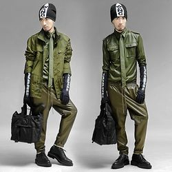 Andre Judd - Alexander Wang Beanie, Sfera Olive Nylon Parka, Alexander Wang Neoprene Gloves, Wax Coated Button Down Shirt, Olive Necktie, H&M Olive Leather Track Pants, Alexander Wang Leather Tote, Raf Simons Flatform Laceups, Leopard Print Socks - MILITARY SPORT