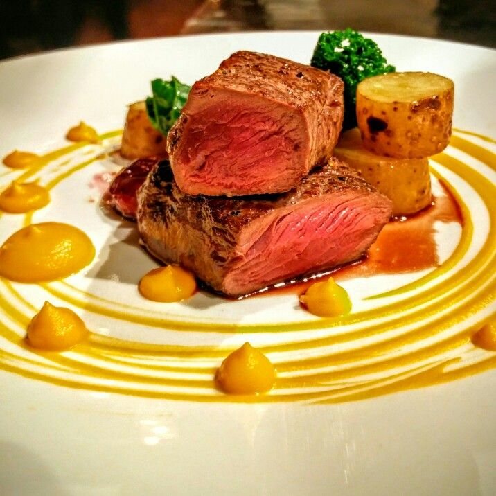 Seared elk loin.  Carrot puree.  Smoked fingerlings. Roasted plums. Kale. Juniper gastrique #eatlocal