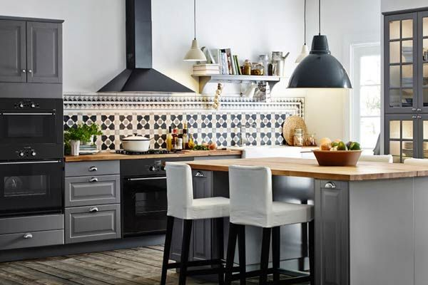 In this airy kitchen, gray cabinets are paired with butcher-block counters, black appliances, and black fixtures for a cozier feel. | AKURUM cabinets, @IKEAUSA