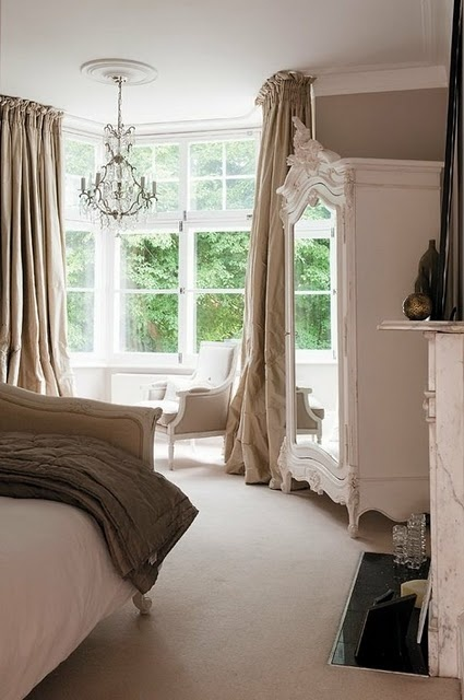 A beautiful, neutral bedroom. Love the chandelier in bay window!