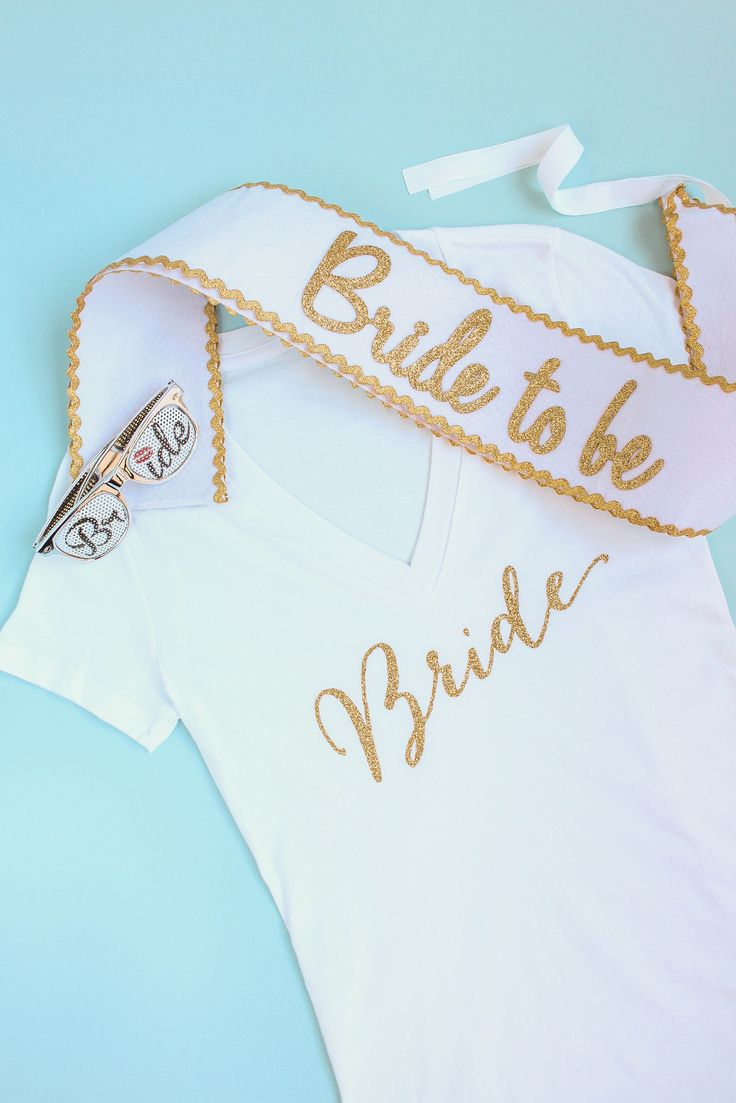 """Dress the bride-to-be in this bride sash before her official big day. This set features an adjustable sash with the words """"Bride to be"""" written in gold glitter. The perfect accessory for any bachelorette party or bridal shower!"""