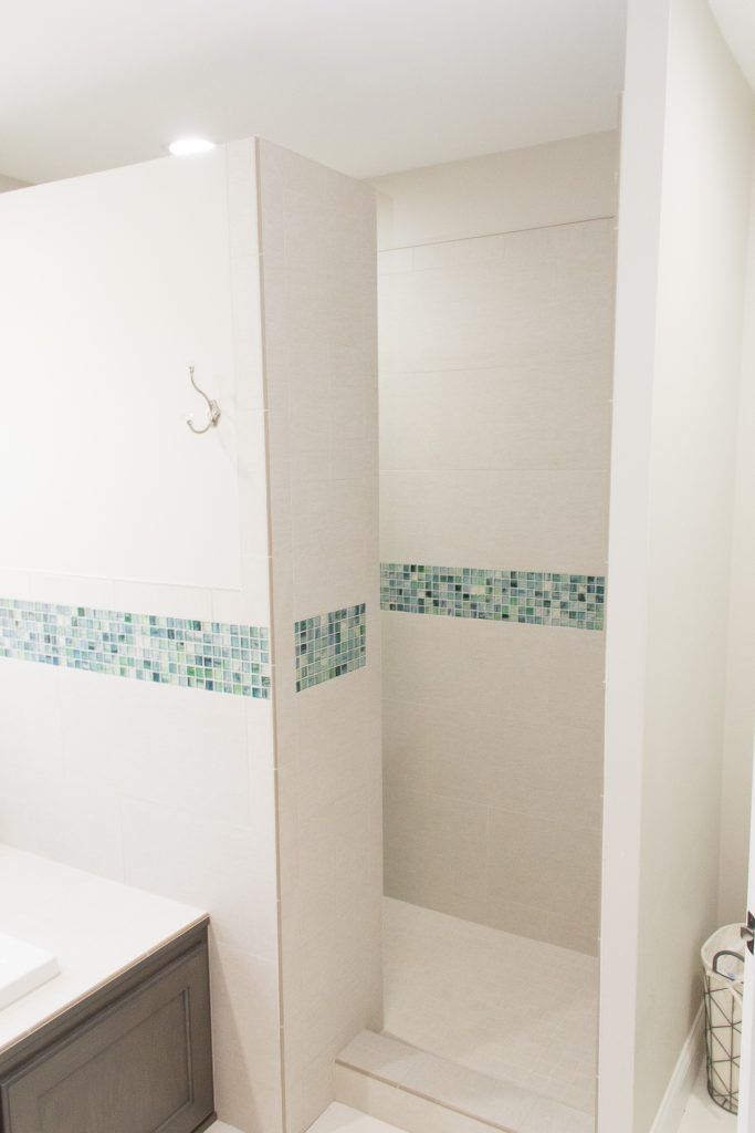 White Tiled Shower with Green and Blue Mosaic Tile Accent | Tiled ...